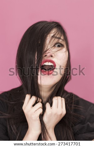 Frightened girl portrait with messy hair - stock photo