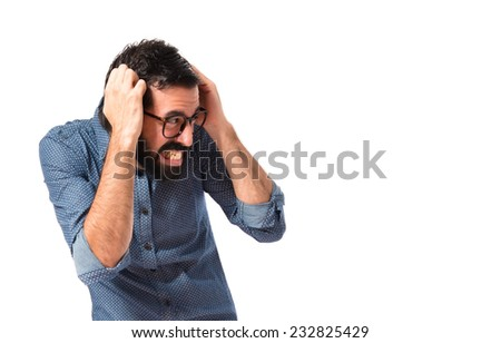 Frightened hipster man over white background - stock photo