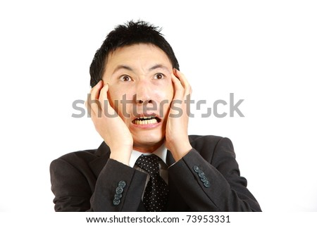 Frightened Japanese businessman - stock photo