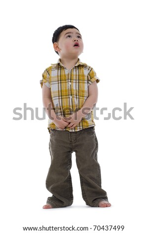 frightened little boy looking up, isolated on white background - stock photo