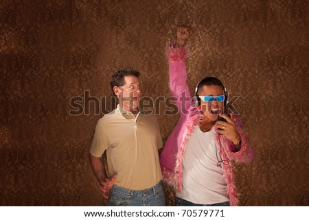 Frightened man next to a strangely dressed neighbor - stock photo