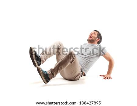 frightened man sitting on the floor - stock photo