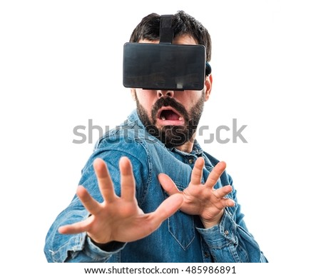 Frightened man using VR glasses