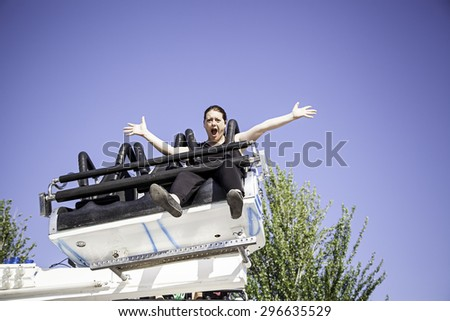 Frightened woman in city fair, risk and danger - stock photo