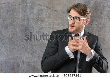 Frightened young businessman - stock photo
