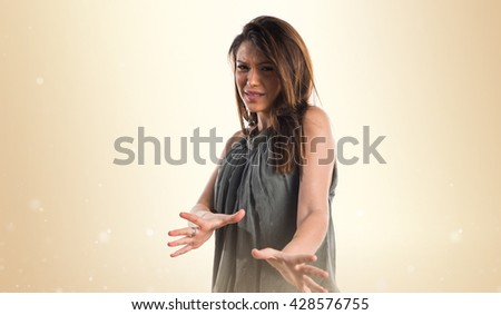 Frightened young girl - stock photo