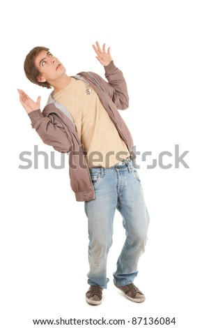 frightened young man in casual jacket, full length
