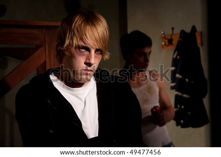 Frightened young man with menacing alcoholic - stock photo