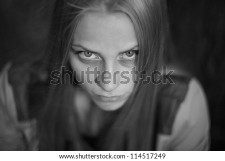 frightened young woman in black and white colors
