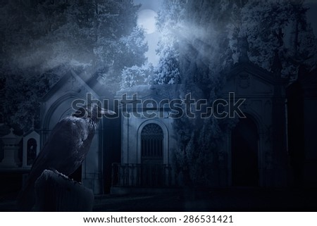 Frightening image with a crow and an old dark cemetery lit by full moon rays - stock photo