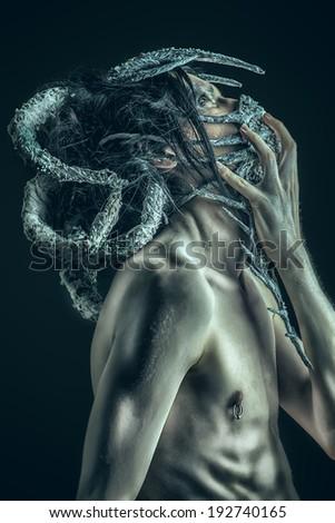 Frightening mythical creature male. Alien creature. Horror. Halloween. - stock photo