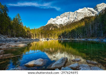 Frillensee (small lake near Eibsee) and Zugspitze - the highest mountain in Germany - stock photo