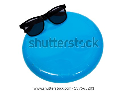 Frisbee and Sunglasses With Copy Space - stock photo