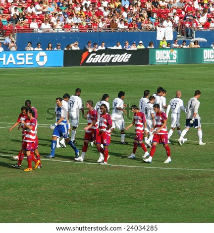 FRISCO - JULY 27: The FC Dallas Hoops and LA Galaxy soccer teams take their position at the start of the game on July 27, 2008 in Frisco, Texas. David Beckham No. 23 walks with his LA team mates.
