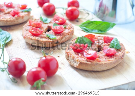 Friselle , typical Italian bruschetta with corn , tomato and basil - stock photo