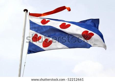 Frisian flag with orange streamer - stock photo