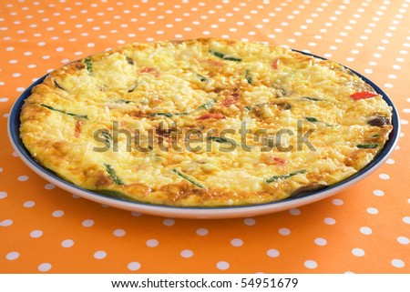 Frittata with asparagus, red bell pepper, mushrooms, ricotta, and parmesan cheese. - stock photo