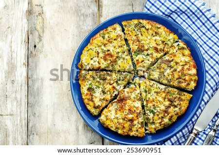 Frittata with chicken and potatoes on a white wood background. tinting. selective focus - stock photo