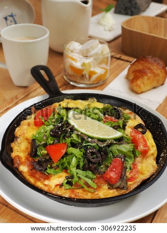 Frittata with potato and broccoli in the pan.    - stock photo