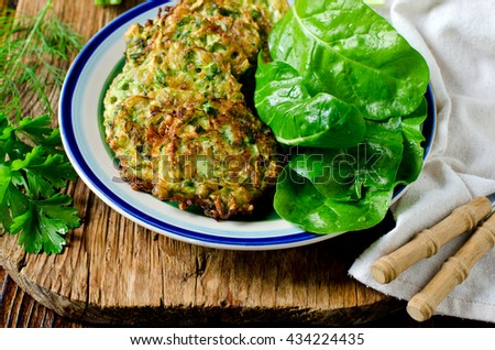 Fritters of zucchini and herbs - stock photo
