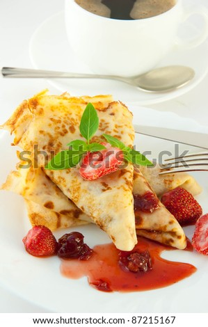 Fritters with strawberry jam and mint and a cup of coffee - stock photo