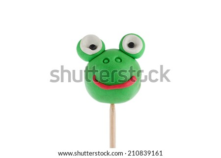 Frog made of plasticine isolated over white  - stock photo
