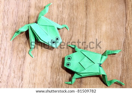 Frog paper on the floor. - stock photo