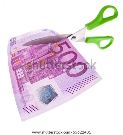 From ? a bill is cut with scissors a piece. Symbol taxes and fees. - stock photo