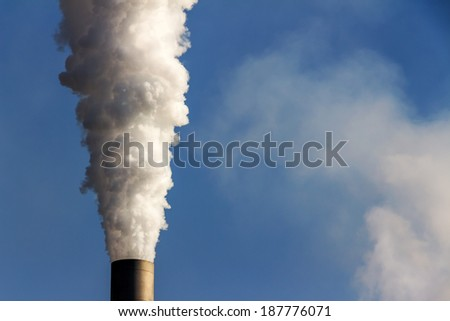 from a smoking chimneys smokes white smog - stock photo
