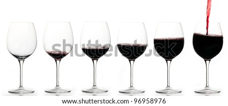 From empty glass to full glass of wine. - stock photo