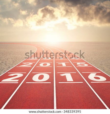 From 2016 into the past concept with numbers on running track in desert against sunset sky - stock photo