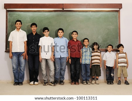 From preschool to college boys - stock photo
