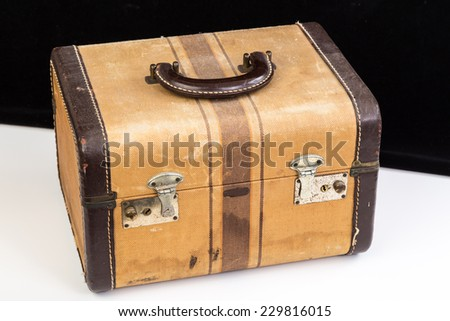 From the days of slumber parties and sleepovers is this well-used antique piece of teenage luggage. - stock photo