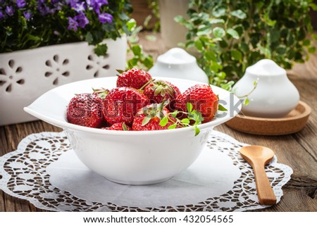 From the home garden: fresh strawberries in white bowl. Selective focus.