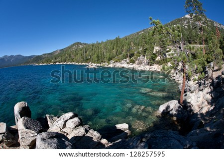 From the Nevada side, Lake Tahoe, in the Sierra Mountains, is quite spectacular.  Ski resorts here are popular in the winter while boating, hiking and mountain biking is popular in the summer. - stock photo