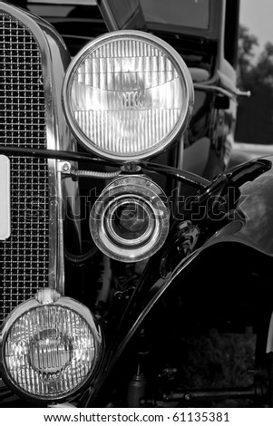 Front and side view of an old antique automobile - stock photo