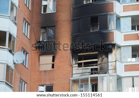 Front and windows of a condominium after an explosion and fire in its apartment. - stock photo