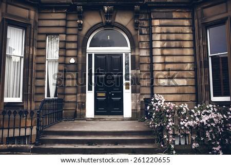 Front black door in Edinburgh, Scotland, UK - stock photo