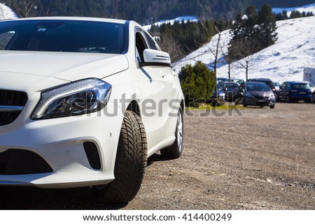 Front closeup view of the brand new white Mercedes 2016 A class parked in Switzerland  - stock photo
