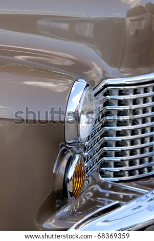 Front details of classic car from side view - stock photo