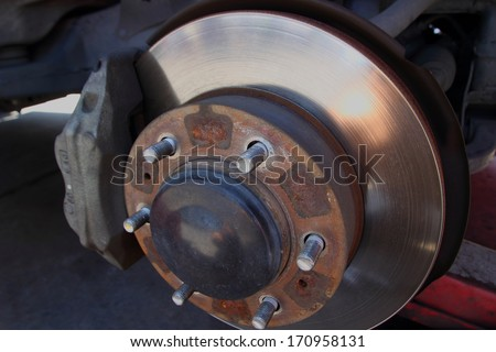 Front Disc Brakes with caliper on car to remove the wheel.