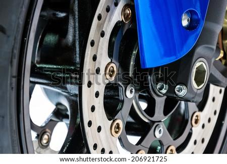 Front disk brake of modern motorbike in motor show. - stock photo