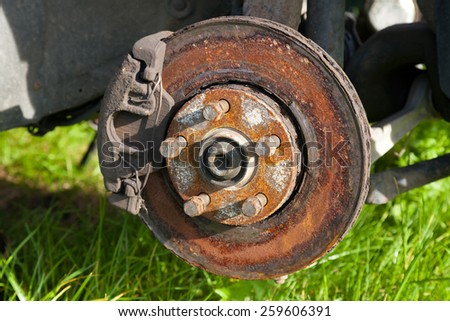 Front disk brake on car in process of damaged tyre replacement.  - stock photo