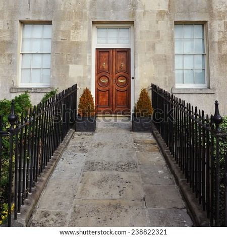 Front Door and Pathway of a Beautiful Georgian Era English Town House - stock photo