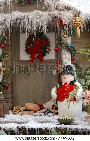 Front door christmas decoration of a wood house - stock photo