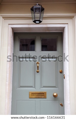 Front Door Exterior Detail of am Attractive Georgian Era London Town House - stock photo