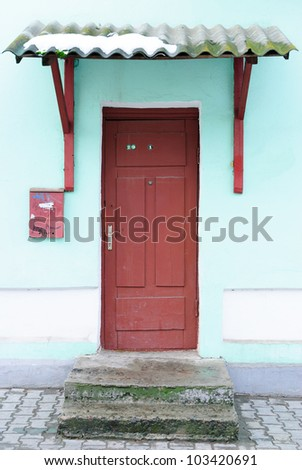 Front door in an old dilapidated house. - stock photo