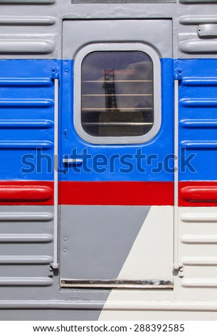 front door in an old passenger wagon with red stripe
