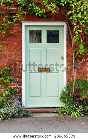 Front Door of a Beautiful Old Red Brick London Town House - stock photo