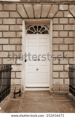 Front Door of a Georgian Era English Town House in Sepia - stock photo